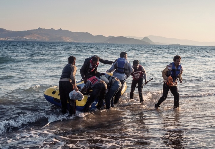 Seven people from Pakistan arrive on the Greek island of Kos after rowing all night.